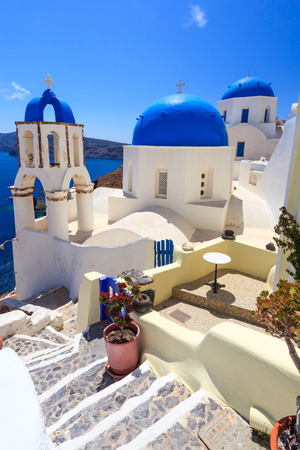 Blue domed churches on the Caldera at Oia on the Greek Island of Santorini. photo