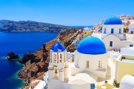 classical greece: Blue domed churches on the Caldera at Oia on the Greek Island of Santorini.
