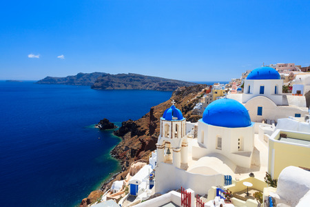 Blue domed churches on the Caldera at Oia on the Greek Island of Santorini. photo