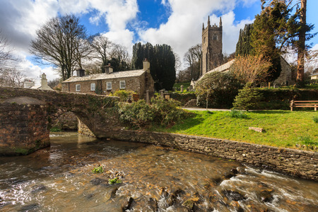 The Church of St Nonna and Pack Horse bridge at Altarnun on Bodmin Moor Cornwall England UK Europe