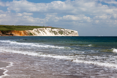 Sandown Beach on the Isle Of Wight with chalk cliffs in the distance England UK Europe Stock Photo