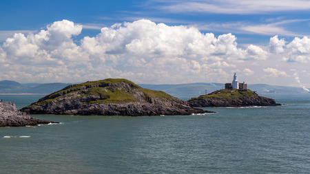 cymru: Mumbles Point and Lighthouse from Bracelet Bay Wales UK Europe