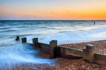 groynes: Groynes at sunset in Milford-on-Sea Hampshire England UK Europe Stock Photo