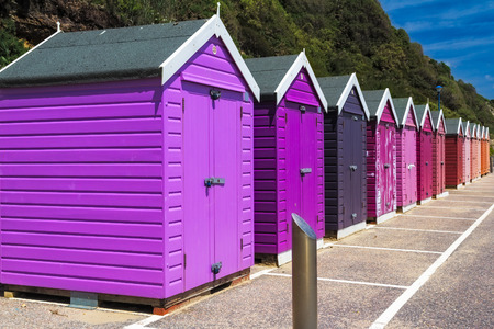 seafront: Colourful wooden beach huts at Bournemouth on the South Coast of England UK Europe