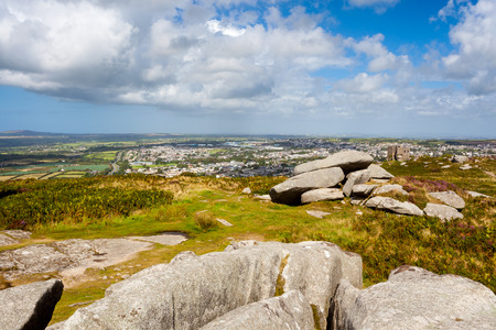 Granite outcrops pm top of Carn Brea hill with Redruth in the distance Cornwall England UK Europe Stock Photo