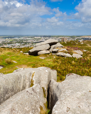 brea: Granite outcrops pm top of Carn Brea hill with Redruth in the distance Cornwall England UK Europe Stock Photo