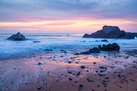 Stunning sunset on the beach at Sandymouth near Bude North Cornwall England UK Europe photo