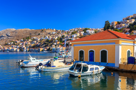 dodecanese: Boats in harbour at Symi Island in the Dodecanese Greece Europe Stock Photo