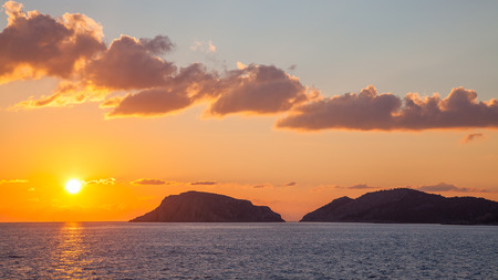 dodecanese: Sunset off the coast of the Greek Island of Symi in the Dodecanese Greece Europe