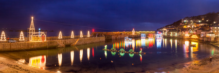 mousehole: Panorama of Christmas Lights at Mousehole Harbour Cornwall England UK Europe