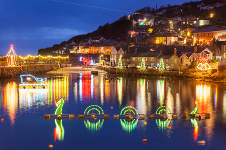 mousehole: Beautiful display of Christmas Lights at Mousehole Harbour Cornwall England UK Europe