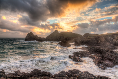 winters: Stormy winters sunset at Kynance Cove on the coast of Cornwall England UK Europe