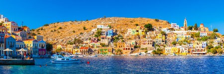 Panoramic shot of the beautiful Harbour at Symi Island in the Dodecanese Greece Europe.