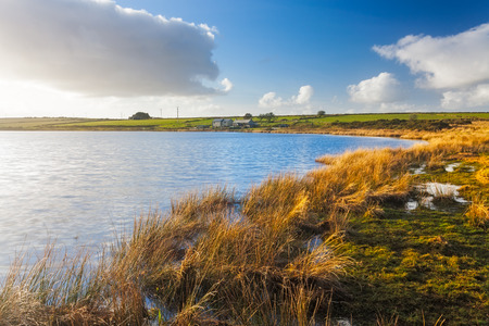 mortally: Dozmary Pool Lake on Bodmin Moor Cornwall England. It is one site that is claimed to be the home of the Lady of the Lake. According to the legend, this is the body of water into which Sir Bedivere threw Excalibur after King Arthur was mortally wounded. Stock Photo