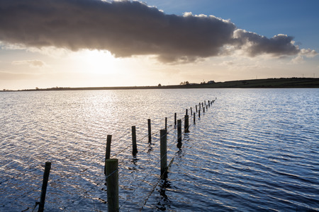 threw: Dozmary Pool Lake on Bodmin Moor Cornwall England. It is one site that is claimed to be the home of the Lady of the Lake. According to the legend, this is the body of water into which Sir Bedivere threw Excalibur after King Arthur was mortally wounded. Stock Photo