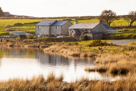mortally: Dozmary Pool Lake on Bodmin Moor Cornwall England. It is one site that is claimed to be the home of the Lady of the Lake. According to the legend, this is the body of water into which Sir Bedivere threw Excalibur after King Arthur was mortally wounded. Editorial