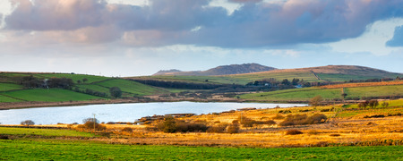 willy: View over Colliford Lake with Brown Willy and Rough Tor hills in the distance, the highest and second highest points in Cornwall England UK