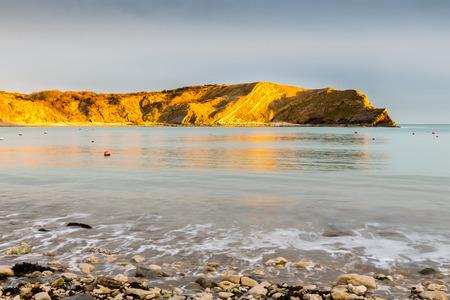 dorset: Late evening light on the cliffs at Lulworth Cove Dorset England UK Europe Stock Photo