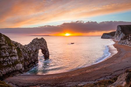 Sunset at Durdle Door natural limestone arch on the Jurassic Coast near Lulworth in Dorset England UK Europe