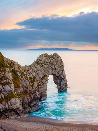 durdle door: Sunset at Durdle Door natural limestone arch on the Jurassic Coast near Lulworth in Dorset England UK Europe