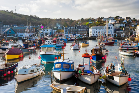 cornish: Small fishing boats in the historic harbour at Mevagissey Cornwall England UK Europe