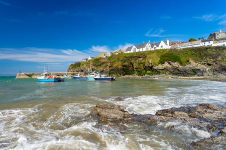 The harbour and beach at Port Isaac Cornwall England UK Europe photo