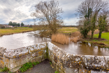 gb: The River Frome and the historic  Wool Bridge Dorset England UK Europe Stock Photo