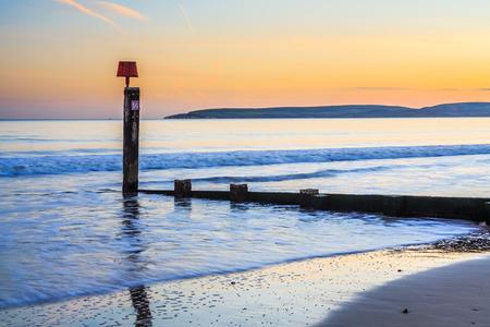 groyne: Groyne on Bournemouth Beach at Sunset Dorset England UK Europe