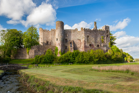 norman castle: Estuary of the River Tâf with Laugharne Castle  in the background Carmarthenshire, Wales UK Europe Stock Photo