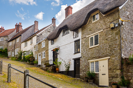 street: Famous view of Picturesque cottages on cobbled street at Gold Hill, Shaftestbury  Dorset England UK Europe
