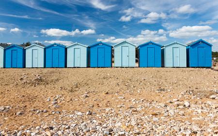 jurassic coast: Beach huts at Charmouth on the Jurassic coast of  Dorset England UK