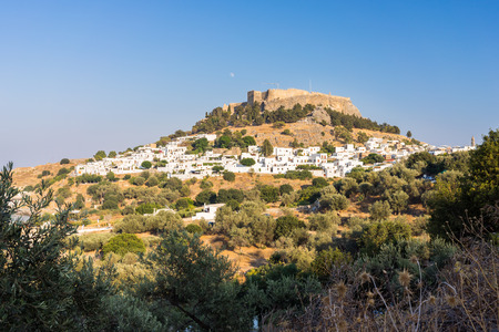 dodecanese: Little white houses with the Castle of Lindos above Rhodes Dodecanese Greece Europe Editorial