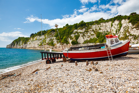 Boats on the beach at Beer, Lyme Bay Devon England UK Europe