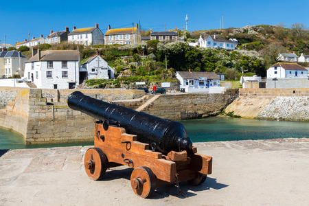 Cannon at Porthleven Harbour  from the wreck of HMS Anson wrecked at nearby Loe Bar on 29 December 1807. Cornwall England UK Europe