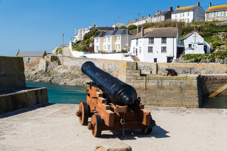 loe: Cannon at Porthleven Harbour  from the wreck of HMS Anson wrecked at nearby Loe Bar on 29 December 1807. Cornwall England UK Europe