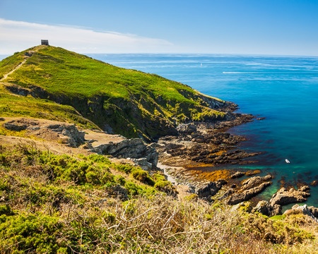 head start: Rame Head at the start of Whitsand Bay as seen from the coast path. Cornwall England UK Stock Photo