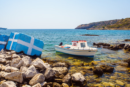 Boat moored at Kathara Beach Faliraki Rhodes Dodecanese Greece Europe