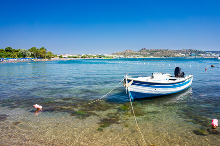 dodecanese: Fishing boat moored on the beach at Faliraki Rhodes Dodecanese Greece  Europe Stock Photo