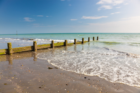 west sussex: Timber Groyne on the beach at Bracklesham Bay on the Manhood Peninsula in West Sussex, England UK Europe Stock Photo