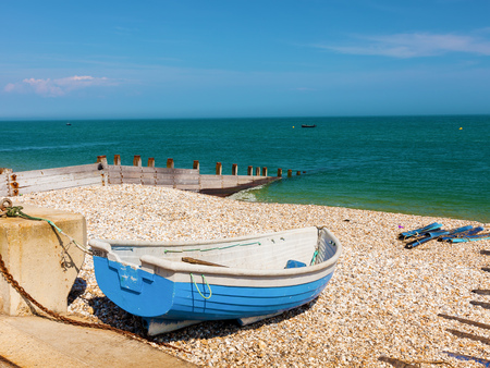 Boat on the shingle beach at Selsey Bill West Sussex England UK Europe Stock Photo