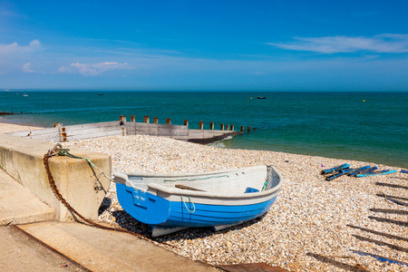 selsey: Boat on the shingle beach at Selsey Bill West Sussex England UK Europe Stock Photo