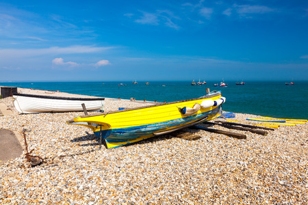 Boats on the shingle beach at Selsey Bill West Sussex England UK Europe Stock Photo