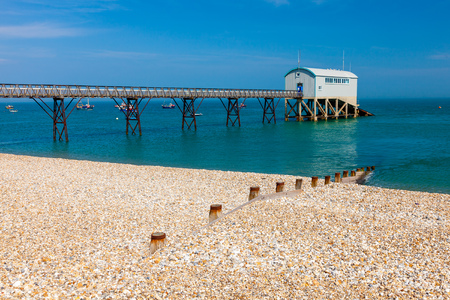 selsey: Selsey Bill beach with the lifeboat station in the background. West Sussex England UK Europe Stock Photo