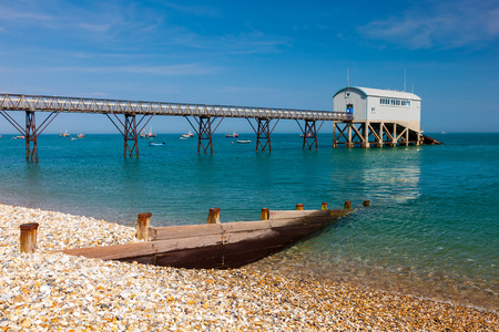 Selsey Bill beach with the lifeboat station in the background. West Sussex England UK Europe Stock Photo