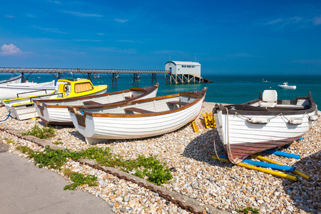 selsey: Boats on the shingle beach at Selsey Bill West Sussex England UK Europe Stock Photo