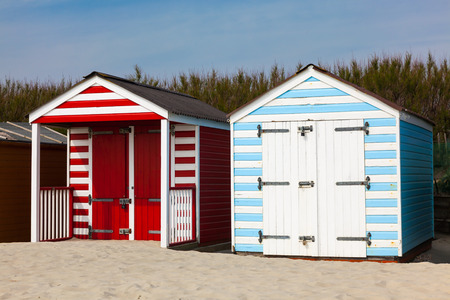 manhood: Traditional beach huts on fine golden sand at West Wittering Beach West Sussex England UK Europe