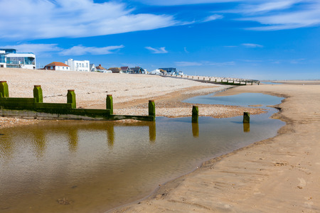 groynes: Timber Groynes on the Golden sandy beach at Camber Sands East Sussex England UK Europe Stock Photo