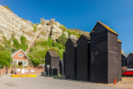 Net loft buildings with Hastings East Cliff Funicular Railway above. East Sussex England UK Europe