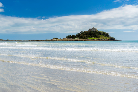 On the beautiful beach at Marazion Cornwall England UK with St Michaels Mount in the background.