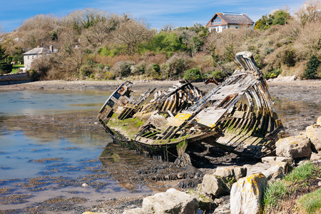 Remains of an abandoned boat at Hooe Lake Plymstock Plymouth Devon England UK